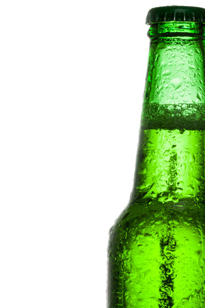 green beer bottle: Green beer bottle with water drops over white background Stock Photo