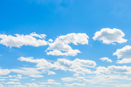 Cumulus clouds, blue sky and sun - outdoors shoot photo