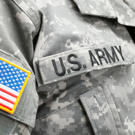 solders: USA flag and U.S. Army patch on solders uniform