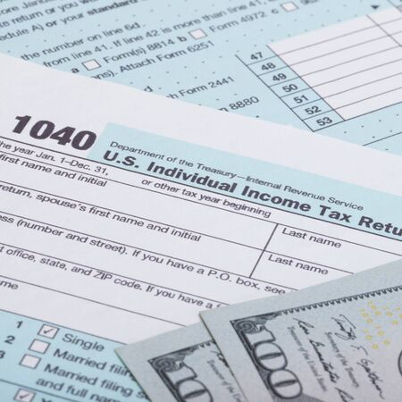 tax form: US 1040 Tax Form and dollars
