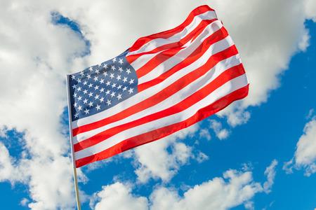 USA flag and cumulus clouds  Standard-Bild