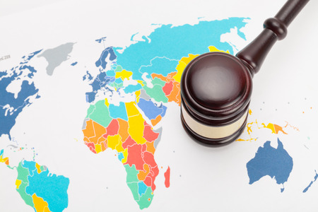Judges gavel and over world map