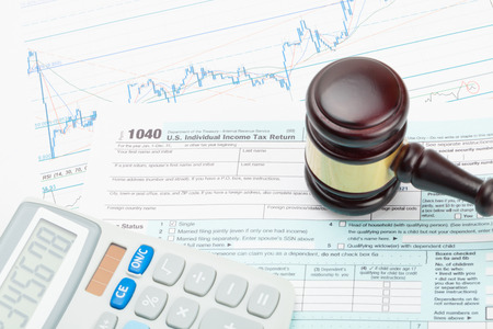 legal office: Judges gavel and calculator over 1040 US Tax form