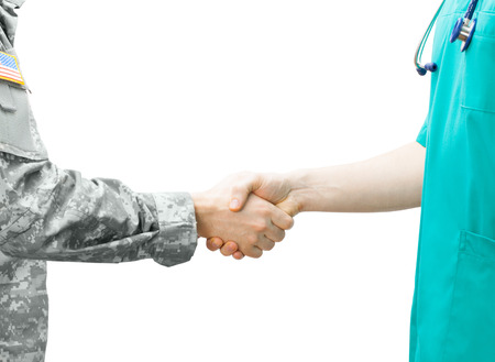 veteran: Soldier and doctor shaking hands Stock Photo