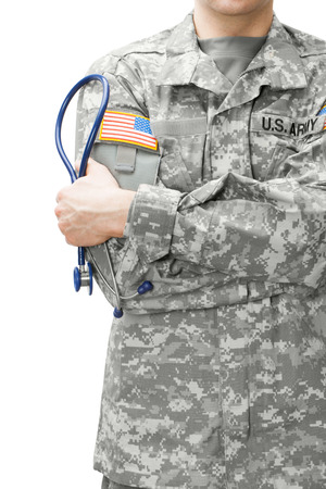 army soldier: US Army doctor holding stethoscope near his shoulder