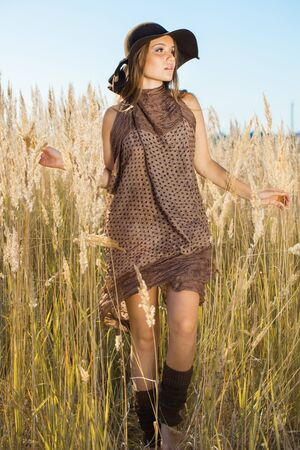 wilds: Beautiful lady model going through meadow wilds