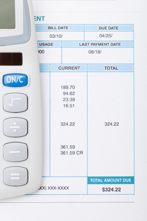 utility payments: Calculator and utility bill next to it