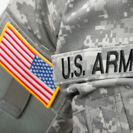 military special forces: U.S. Army and flag patch on solder uniform