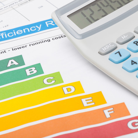 utility payments: Colorful energy efficiency chart and calculator - close up shot