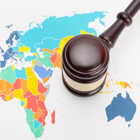 international criminal court: Judges gavel and over world map - close up shot Stock Photo