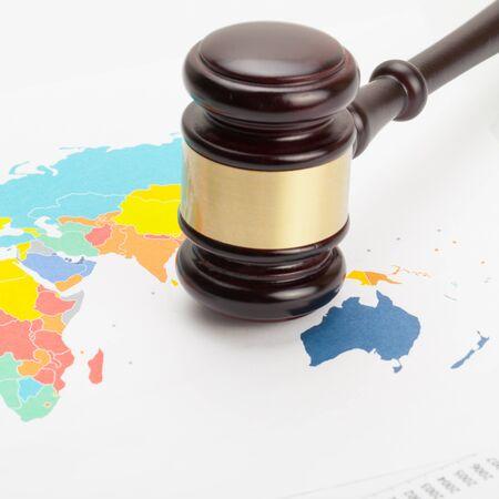 international criminal court: Judges gavel over colorful world map - close up shot
