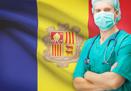 tourism in andorra: Surgeon with national flag on background - Andorra