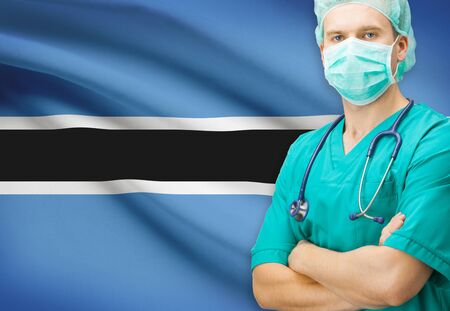 botswanan: Surgeon with national flag on background - Botswana Stock Photo