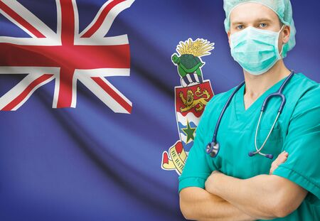 Surgeon with national flag on background - Cayman Islands photo