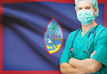 guam: Surgeon with national flag on background - Guam Stock Photo