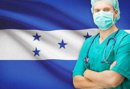 Surgeon with national flag on background - Honduras photo