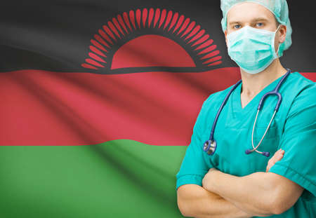 malawian flag: Surgeon with national flag on background - Malawi