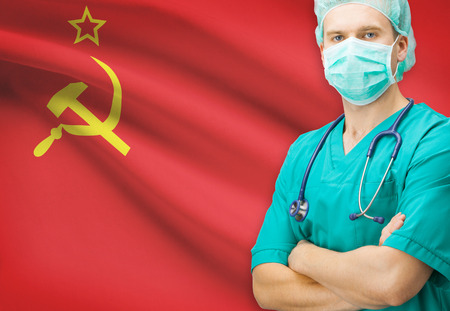 soviet flag: Surgeon with national flag on background - Union of Soviet Socialist Republics