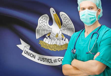 louisiana flag: Surgeon with US state flag on background - Louisiana
