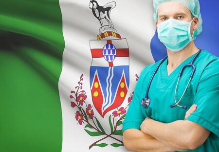 yukon: Surgeon with Canadian privinces flag on background - Yukon
