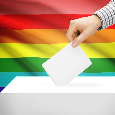 electoral system: Ballot box with national flag on background series - LGBT flag Stock Photo
