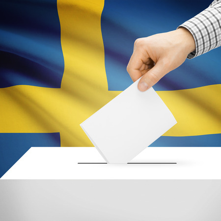 electoral system: Ballot box with national flag on background series - Sweden Stock Photo