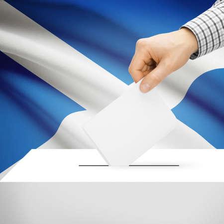 scottish parliament: Ballot box with national flag on background series - Scotland Stock Photo