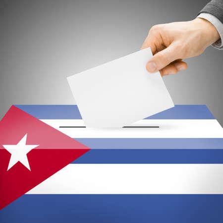 Ballot box painted into Cuba national flag colors  photo
