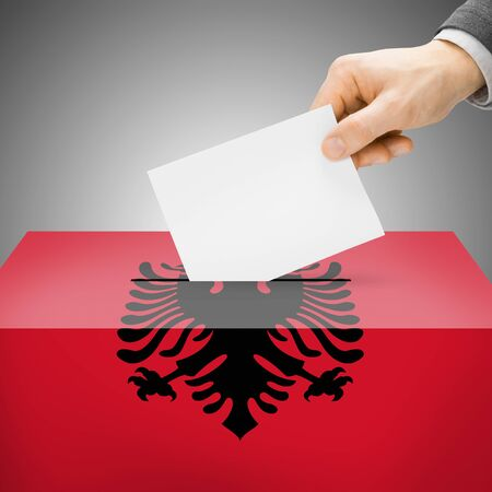 electoral system: Ballot box painted into Albania national flag colors