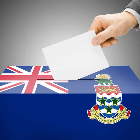 Ballot box painted into Cayman Islands national flag colors photo