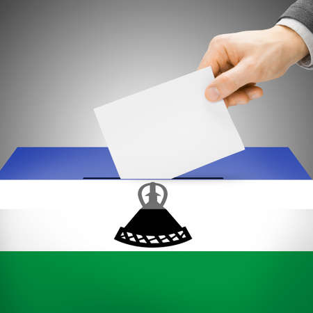 polling booth: Ballot box painted into Lesotho national flag colors Stock Photo