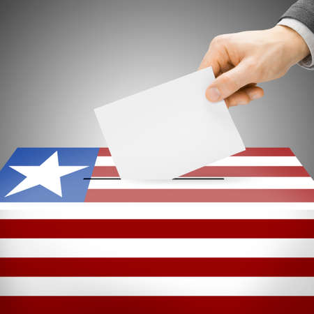 polling booth: Ballot box painted into Liberia national flag colors Stock Photo