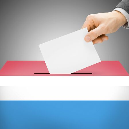 Ballot box painted into Luxembourg national flag colors