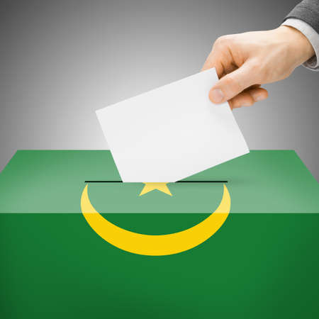 Ballot box painted into Mauritania national flag colors photo