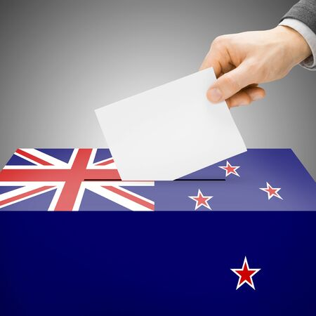 local election: Ballot box painted into New Zealand national flag colors Stock Photo