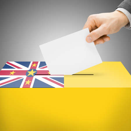 plebiscite: Ballot box painted into national flag colors - Niue Stock Photo