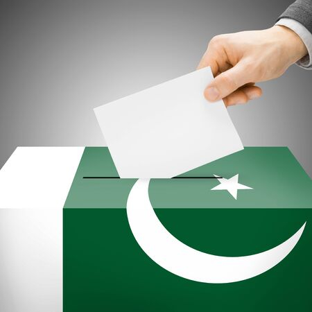 Ballot box painted into Pakistan national flag colors photo