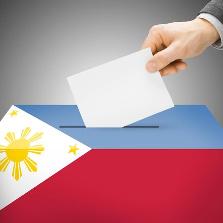 Ballot box painted into  Philippines national flag colors photo