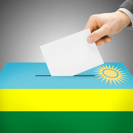 Ballot box painted into Rwanda national flag colors Stock Photo