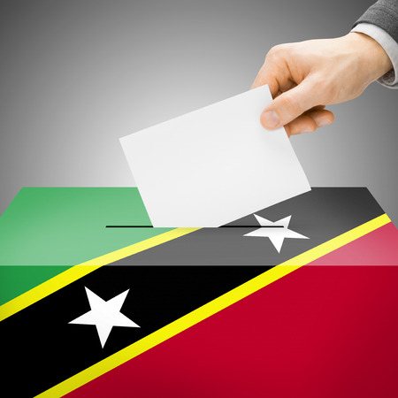 polling booth: Ballot box painted into Saint Kitts and Nevis national flag colors Stock Photo