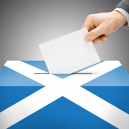 scottish parliament: Ballot box painted into Scotland national flag colors