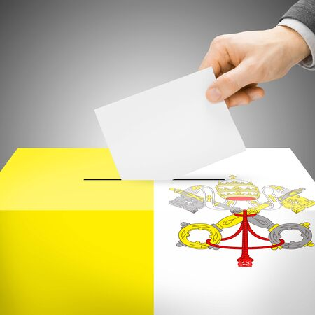 electoral system: Ballot box painted into Vatican City national flag colors Stock Photo