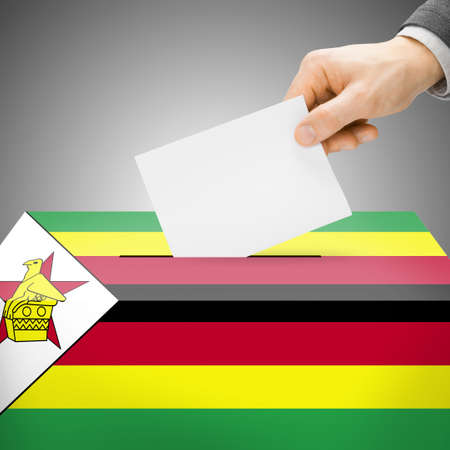 Voting concept - Ballot box painted into national flag colors - Zimbabwe photo