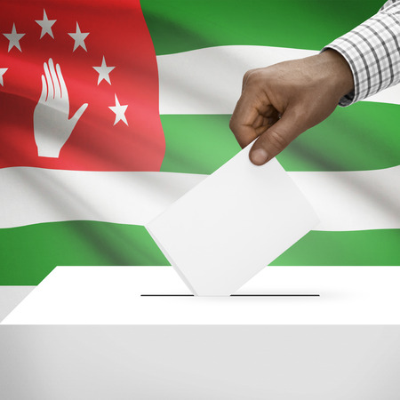 electoral system: Ballot box with flag on background - Abkhazia