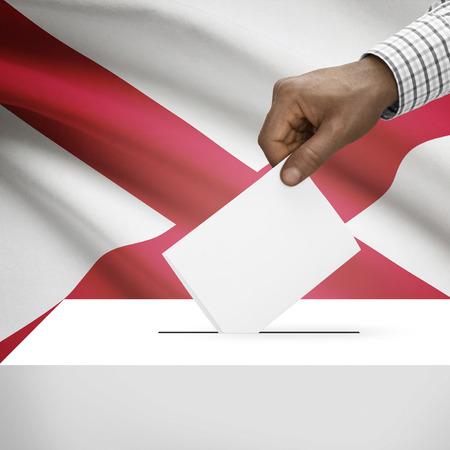 alabama flag: Ballot box with US state flag on background - Alabama