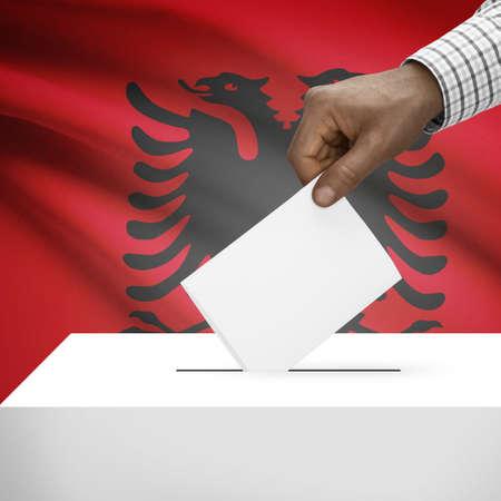 Ballot box with flag on background - Albania photo