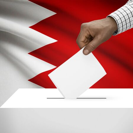 electoral system: Ballot box with flag on background - Bahrain