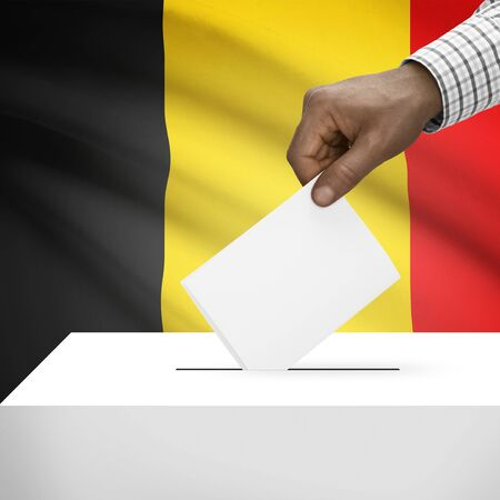 polling booth: Ballot box with flag on background - Belgium