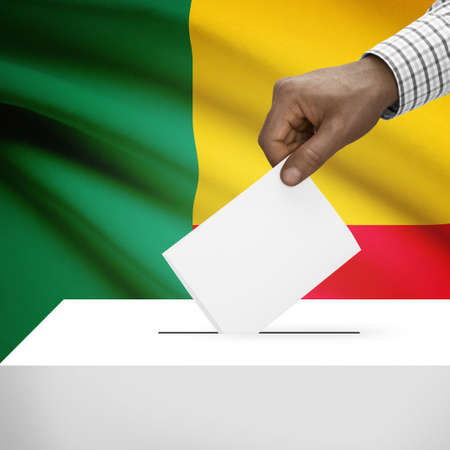 benin: Ballot box with flag on background - Benin