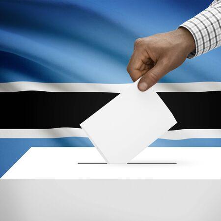 botswanan: Ballot box with flag on background - Botswana